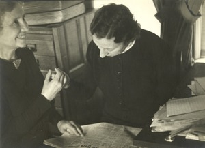 Helen Keller and Polly Thomson Reading a Newspaper