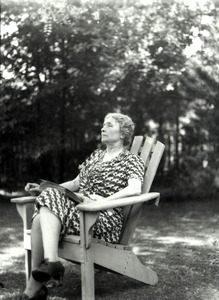 Helen Keller Reading Outside