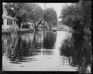 A boat moves on the flooded waters