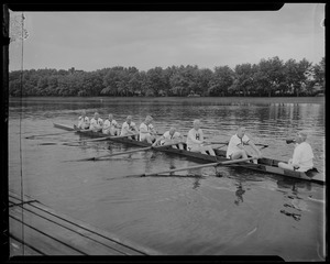 Close up of Harvard Crew team of 1914 in the boat, getting ready to row during reunion