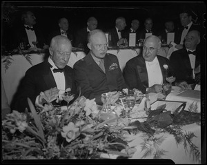General Eisenhower at dinner with Boston University President Daniel L. Marsh on his left, and another man on his right