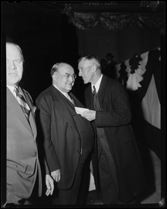 Edward R. Mitton , president of Jordan Marsh talking to Senator Leverett Saltonstall