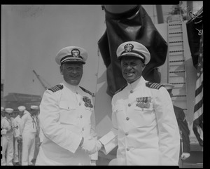Captain J.F. Enright and Captain G.T. Ferguson, shaking hands at U.S.S. Boston change of command ceremonies at Charlestown Navy Yards