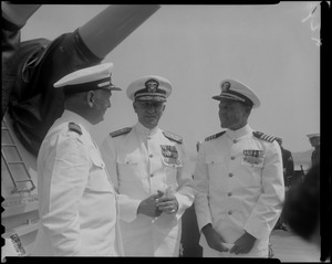 Captain J.F. Enright, left, and Captain G.T. Ferguson, right, with another officer at the U.S.S. Boston change of command ceremonies at Charlestown Navy Yards