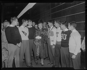 Lana Turner with men in collegiate sweaters including Harvard, Boston University and Tufts