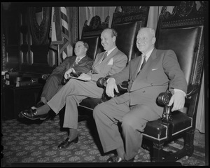 William Randolph Hearst Jr. and two others sitting in the chairs of the Legislature