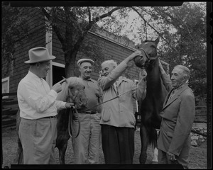 Walter Gibbons, Jimmy Jordan, Paul Wixom and one other man standing with horses