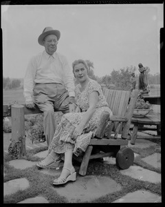 Walter and Madeline Gibbons sitting outside