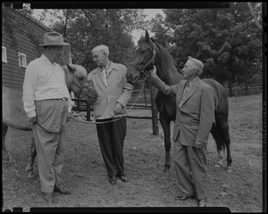 Walter Gibbons, Paul Wixom and one other man next to two horses