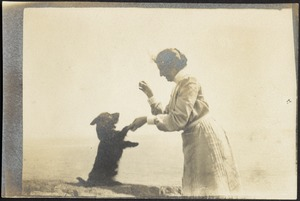 """Helen Stevens Coolidge playing with dog (possibly """"Ping"""")"""