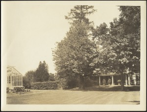Greenhouse, grounds, side porch of house
