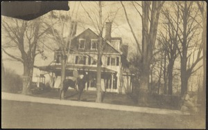 G. Otto Kunhardt on horse in front of main house