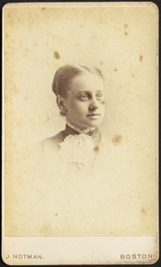 Young woman wearing high collar with white ruffle