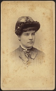 Young woman wearing ornate bonnet