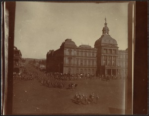 Soldiers in formation in city square near Council Chamber