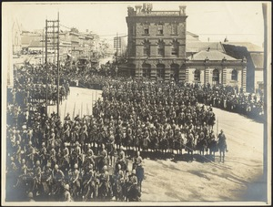 Mounted British soldiers in formation in city square near Council Chamber