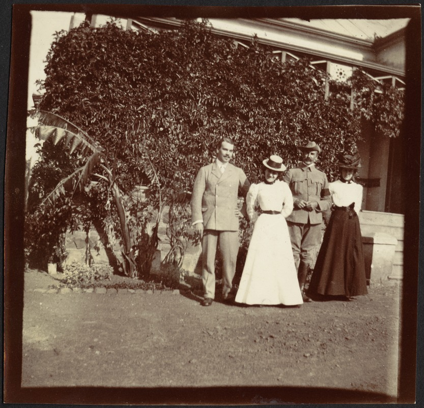 Adelbert S. Hay standing in garden with friends (two women and a cavalry officer)