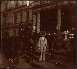 Soldiers on horseback and crowd of people standing in front of Council Chamber