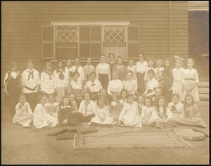 Miss Kate Carroll, teachers and school girls in front of 147 Prince Street school
