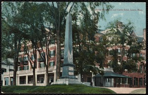 Curtis Hotel: Paterson Monument and Curtis Hotel, shaded by trees.