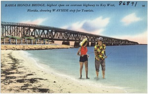 Bahia Honda Bridge, highest span on overseas highway to Key West, Florida, showing wayside stop for tourists