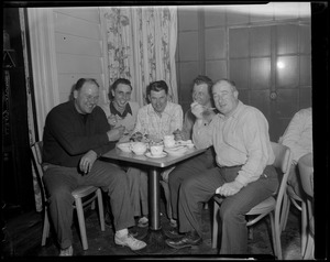 5 men eating at a table