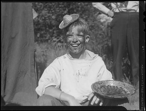Boy in pie eating contest