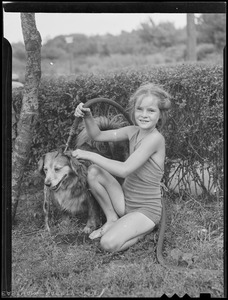 Young girl washing her dog