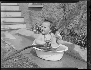 Baby cools off in wash tub