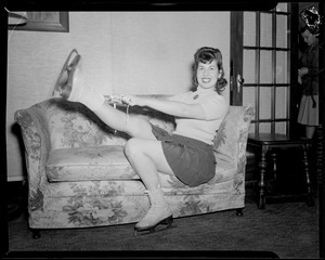 Girl lacing up skates on love seat - cheesecake
