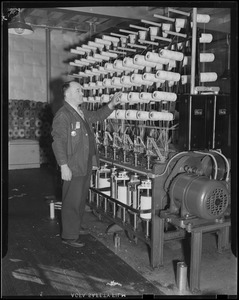 Edward Carey - leading man, standing beside cotton forming machine. He has been at this work 20 years.