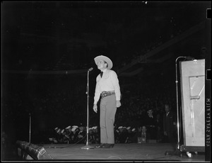 Buck Jones, cowboy star, performing