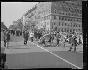 Archbishop Cushing marches in parade