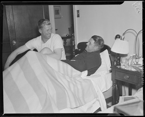 Lefty Grove taking care of his teammate Jimmie Foxx in their hotel room
