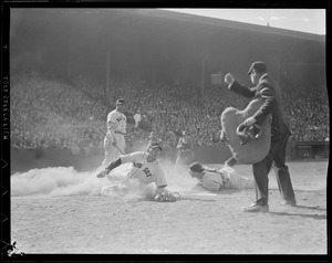 Bill Dickey of the Yankees tags out Red Sox runner at the plate while Jimmie Foxx looks on