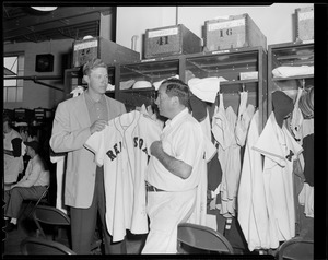 Red Sox player and attendant in clubhouse at Fenway