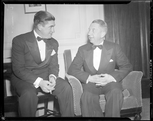 Eddie Collins of the Sox in tuxedo, conversing