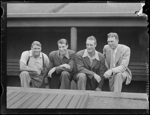 Foxx, DiMaggio, Gehrig and other man in Fenway dugout
