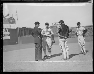 Players, umpire conference at Fenway