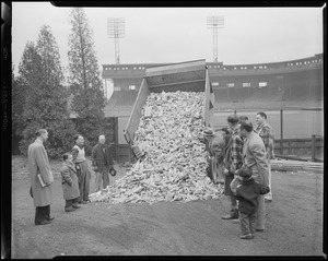 Truck dumping load of Boston College tickets at Braves Field