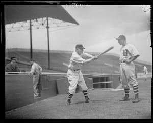 Casey Stengel instructs one of his players on the finer points of hitting