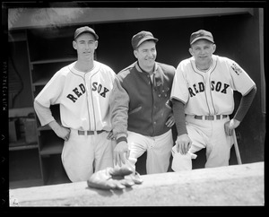 A young Ted Williams in Fenway dugout with teammates