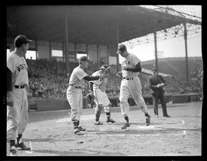 Ted Williams crosses the plate