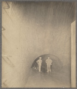 Men standing in sewer