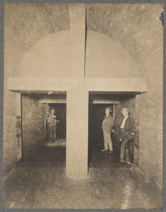 Men and worker standing in divided sewer