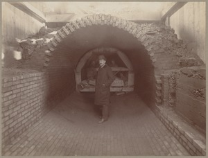 Man standing in unfinished sewer