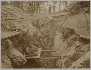 Men standing over unfinished sewer
