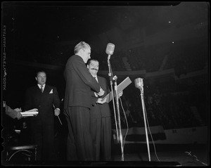 Acting Mayor of Boston John E. Kerrigan shaking hands and presenting award to Jerry Colonna while Bob Hope looks on