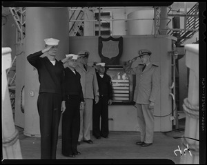 Cyrus B. Holcomb, Theodore Zelany, Robert W. Coleman, and John Ziemba, crew members of USS Albany, salute deck officer Ens. Thomas Tivnan on deck of U.S.S. Albany for final time before its decommissioning