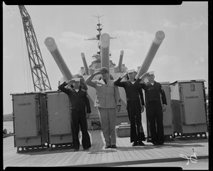 Cyrus B. Holcomb, Theodore Zelany, Robert W. Coleman, and John Ziemba, crew members of USS Albany, saluting on ship deck before its decommission